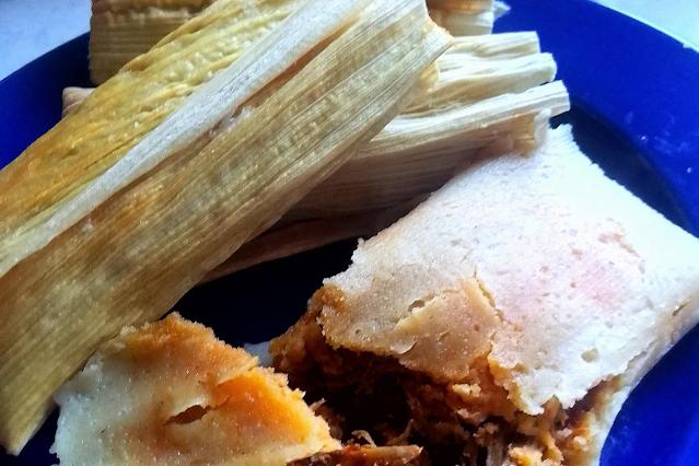 pork tamales on blue plate