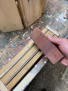 Using a dampened whetstone