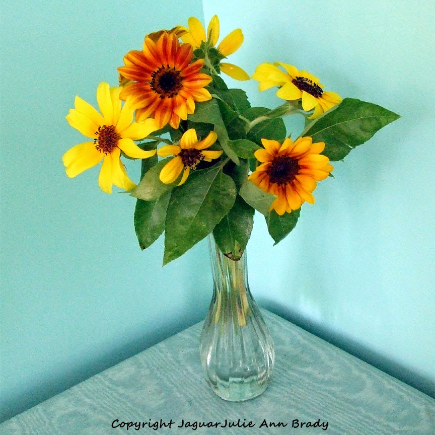 Sunflowers in a Glass Bud Vase