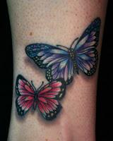 tatuaje de mariposas coloridas