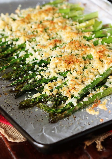 Roasted Asparagus with Crunchy Parmesan Topping on Baking Sheet Image