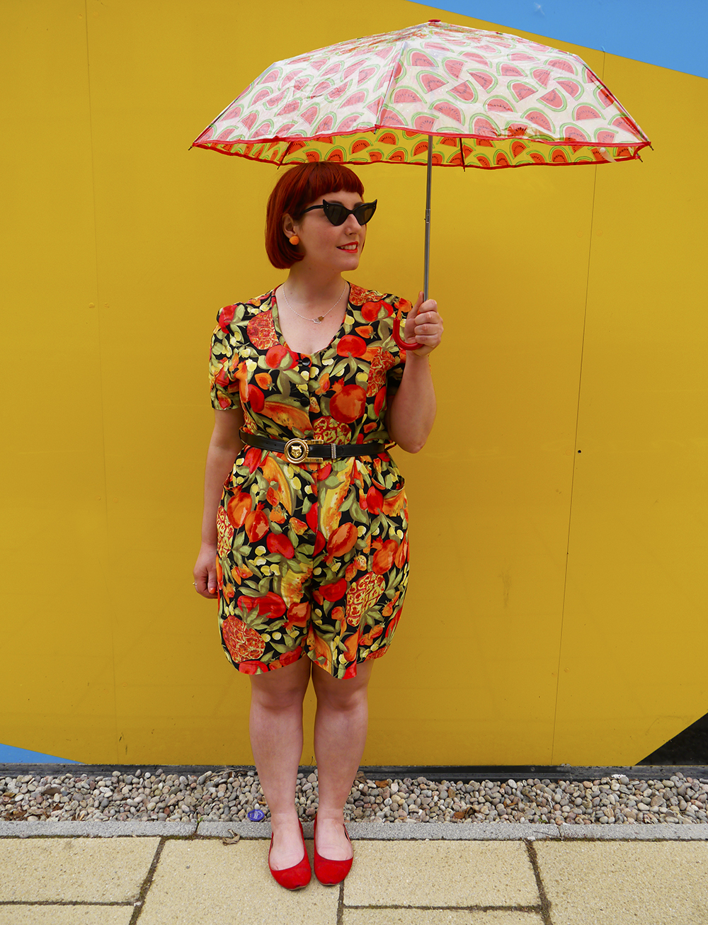 Wardrobe Conversations, Scottish blogger, Scot Street style, Edinburgh Blogger, Edinburgh street style, vintage street style, summer outfit, summer street style, playsuit, fruit pattern playsuit, vintage playsuit, umbrella, watermelon umbrella, colourful blogger style, bright colours, Nicely Eclectic vintage, Paperchae umbrella, Vintage sunglasses, cat eye sunglasses, summer style, summer tan, fake tan, natural fake tan, easy fake tan, tanning tips