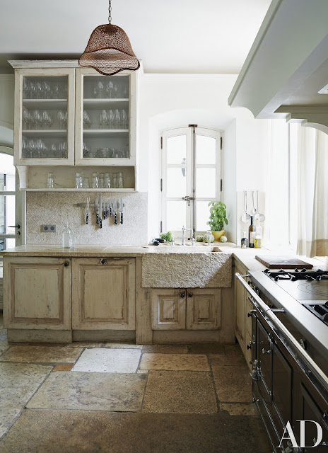South Of France Home | Kitchen: stone pavers from Burgundy and a 17th-century Provençal sink.