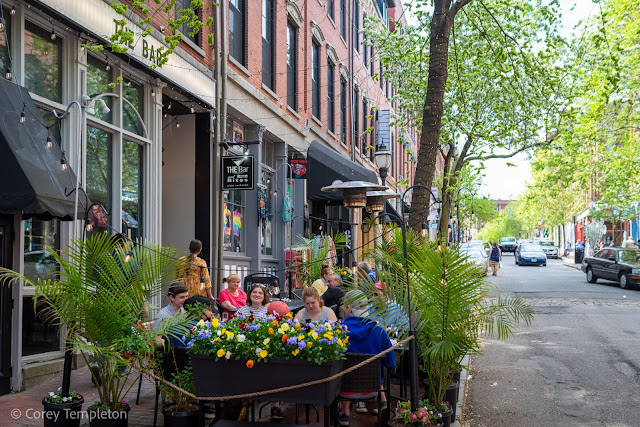 """Portland, Maine May 2021 photo by Corey Templeton. A festive dining habitat in front of """"The Bar & Bites"""" on Exchange Street."""