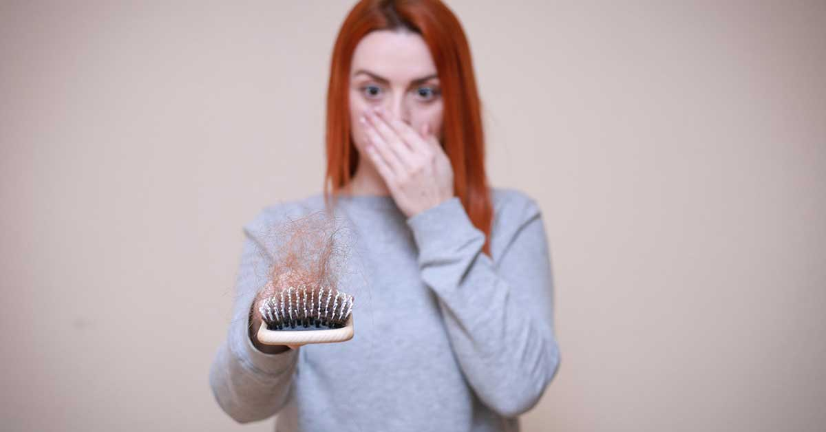 How can I reduce my post pregnancy hair loss naturally?