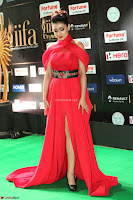 Apoorva in a Stunning Tight Leg Split Sleeveless Red Gown at IIFA Utsavam Awards 67.JPG