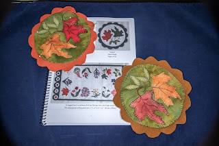 book with two coasters appliqued with leaves