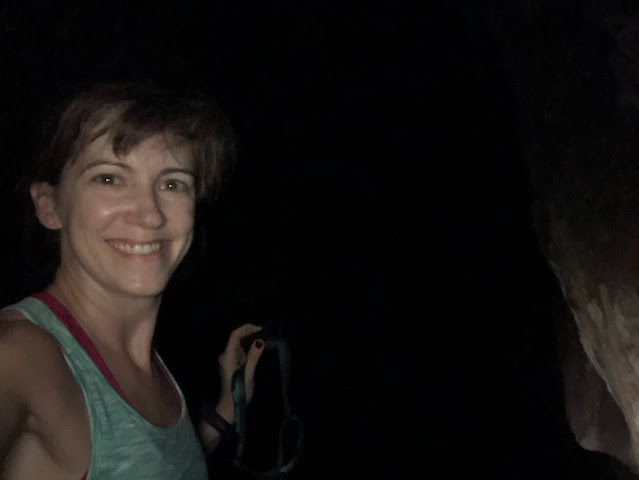 woman standing in a dark cave