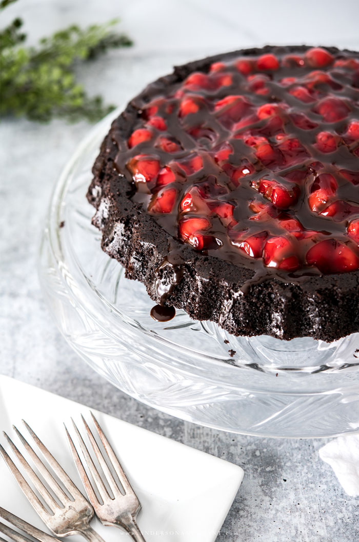 Black forest cake on clear glass cake stand