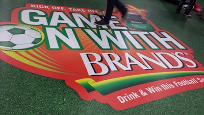 "Brand's has a campaign on in Dhoby Ghaut MRT station where the company invites fans to ""Game On with Brand's: drink & win this football season""."