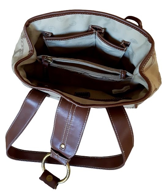 A tan coloured canvas purse with brown leather straps and handles, and a zippered interior section.