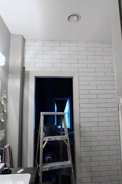 extending tile outside of shower along door wall