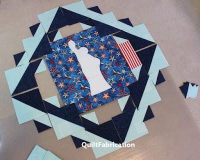 aqua, blue, and patriotic fabrics laid out