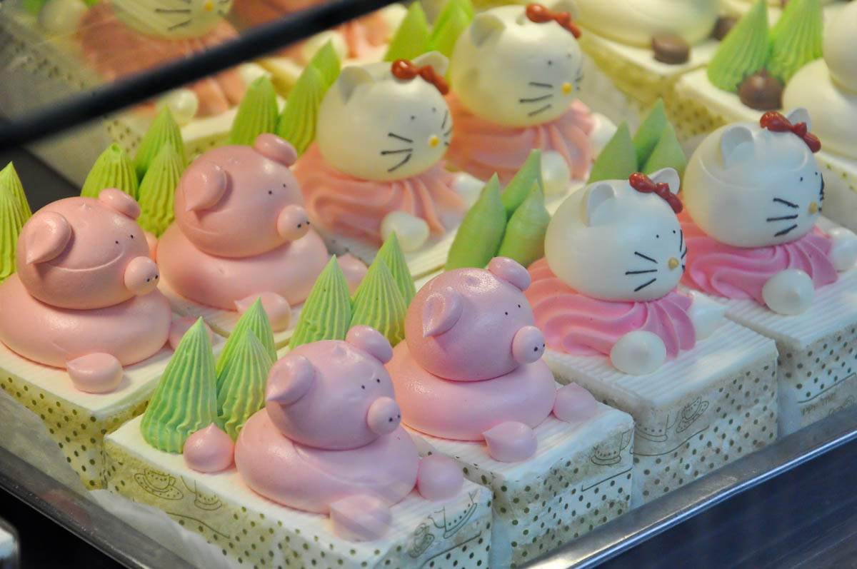 Chinese fancy cakes, Close-up of the window display of a Chinese bakery, Chinatown, London, England