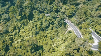 A royalty free of aerial drone shot of  - the road to pusuk monkey forest of Lombok