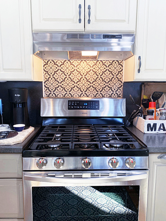 stove with tiled wall after photo