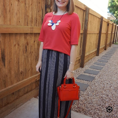 awayfromtheblue Instagram | red slouchy tee with vertical stripe maxi skirt statement necklace