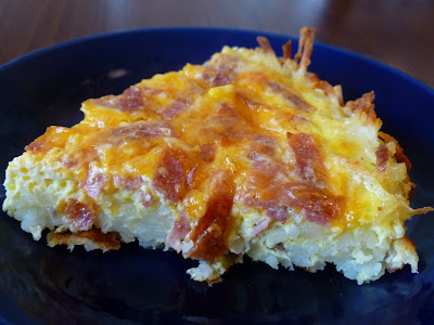 https://joyfulhomemaking.com/2012/01/quiche-with-hash-brown-crust.html