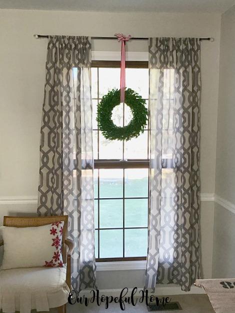 boxwood wreath hanging window drapes