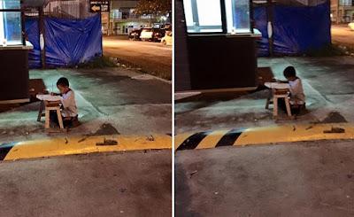 Sem casa, garoto de 9 anos estuda em calçada nas Filipinas
