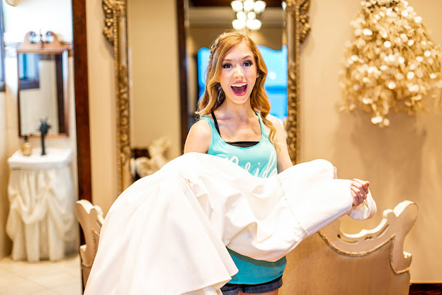 excited bride with her wedding dress