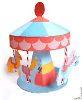 http://del4yo.squarespace.com/non-dairy-diary/2012/5/24/merry-go-round-paper-toy.html