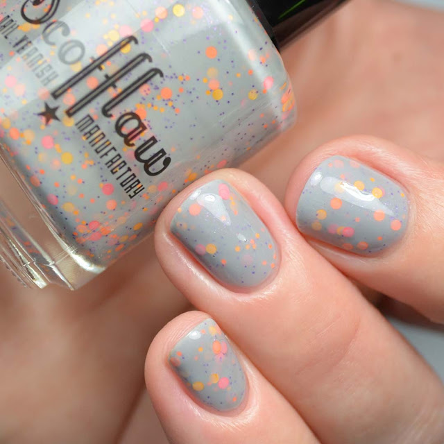 grey crelly nail polish with glitter
