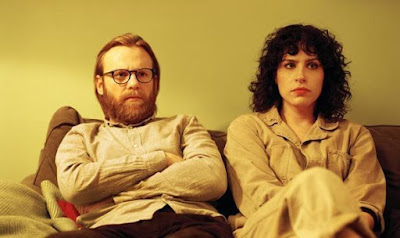 Picture of Leila (played by Desiree Akhavan) and Gabe (played by Brian Gleeson)