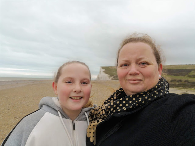 mother and tween daughter by the cliffs