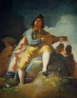 najo de la Guitarra, óleo de Goyan en el que un hombre canta y toca la guitarra en el campo, vestido con el traje de majo en vivos colores