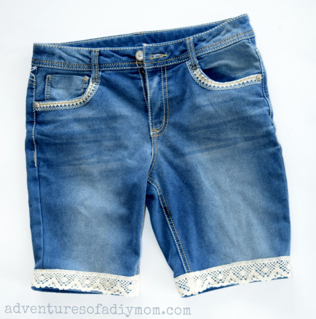 How to make cutoff shorts with a lace accent. An easy DIY that's so stinkin' cute for your little girls. #cutoffshorts #shortsforkids #diycutoffs #cutofftutorials #howtomakecutoffs #cutoffshortstutorial #cutoffshortideas #adventuresofadiymom