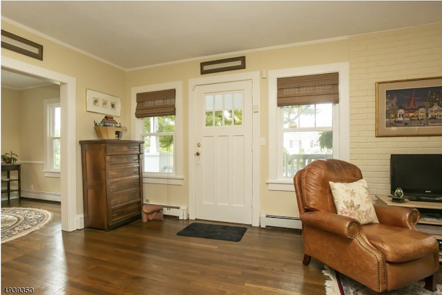 color living room photo showing front door and windows around it, Sears Uriel or Sears Conway • 5 Orchard Street, Mendham, New Jersey