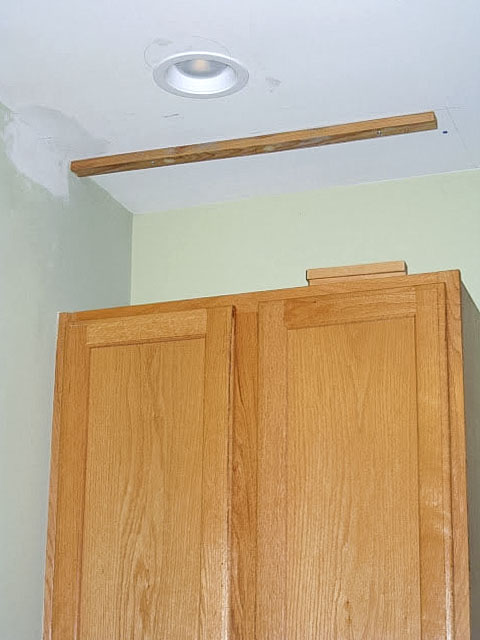 Oak cabinet ready to being close above and up to the ceiling.