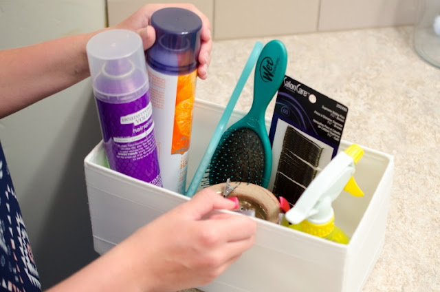 hairbrush organizer in bathroom