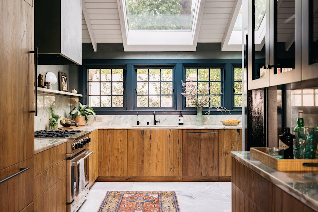 The skylight above the sink frames the liquid amber tree in the front yard.