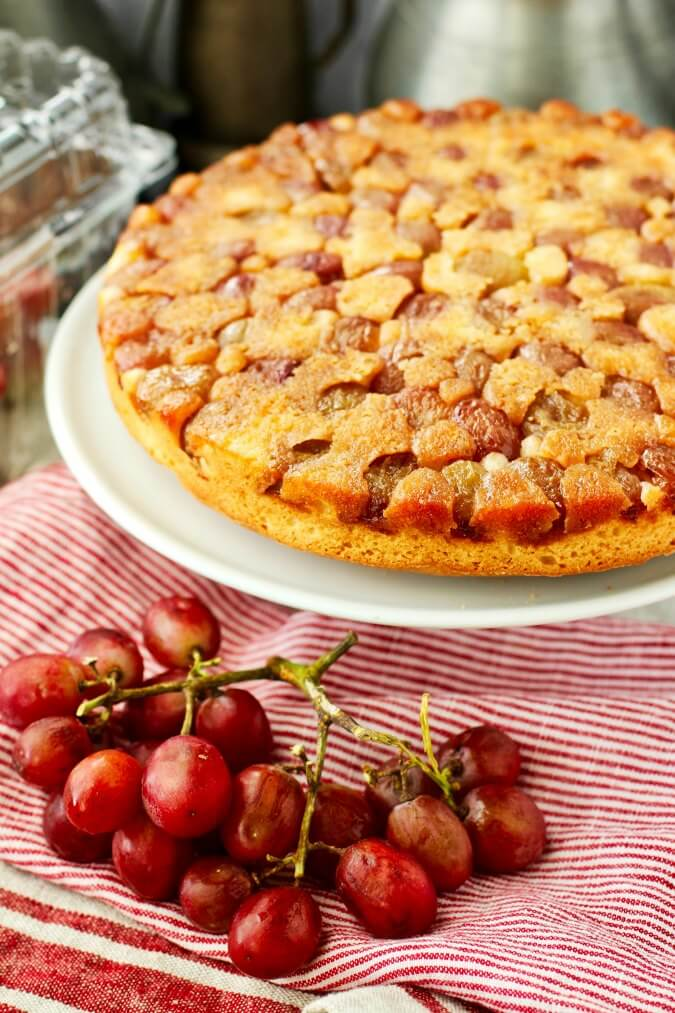 Grape upside down cake on cake plate