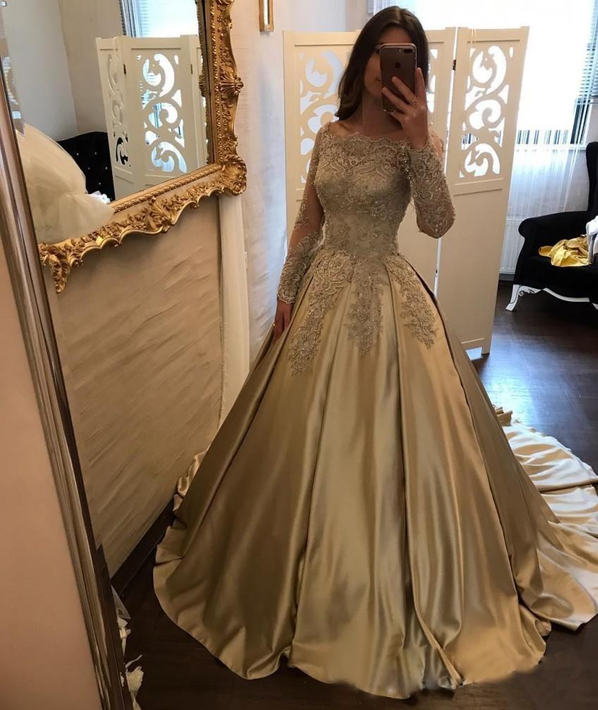 http://www.babyonlinedress.fr/g/forme-princesse-robe-de-soiree-dentelle-col-bateau-manches-longues-robe-pas-cher-107632.html?source=blog