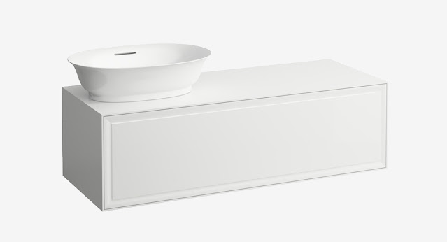 A simple white vanity with spare styling by Laufen.