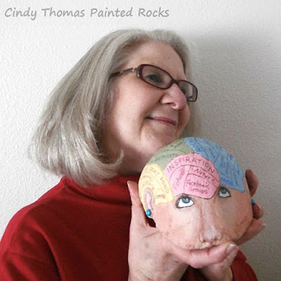 Cindy Thomas with a Brain Painted on a Rock