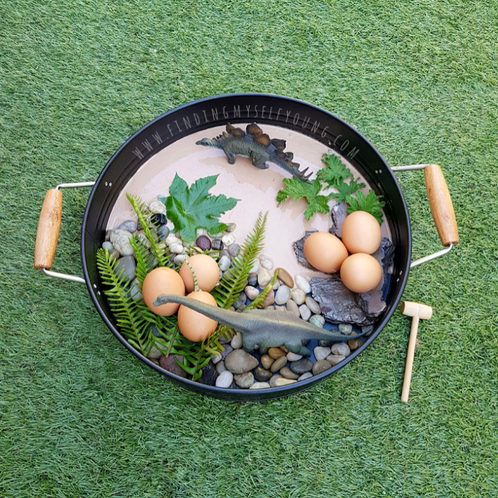 Dinosaur sensory small world play tray with chocolate flavoured mud.