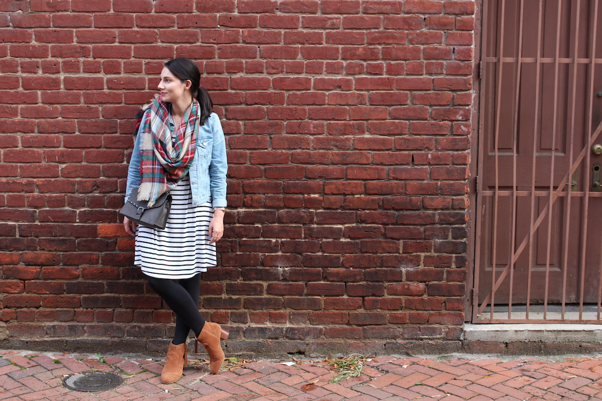 This is a shot of my fall outfit with denim jacket, plaid scarf, black and white striped dress, leggings and booties.