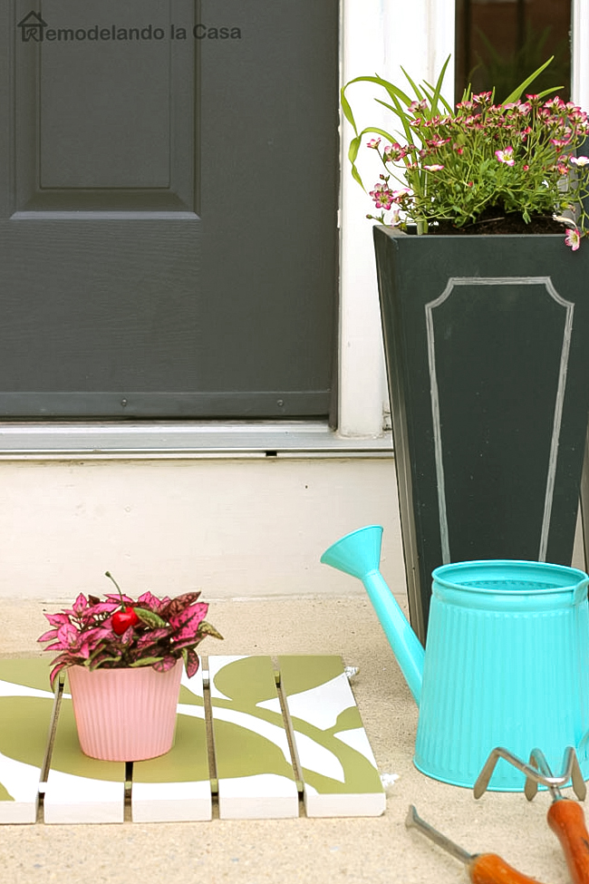 Front porch decorated for Spring - Green door