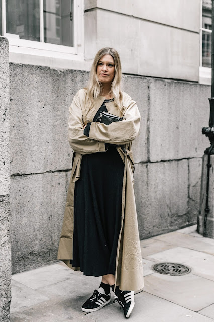 you can pair your favorite sneakers with trench coat and black long dress for more office look