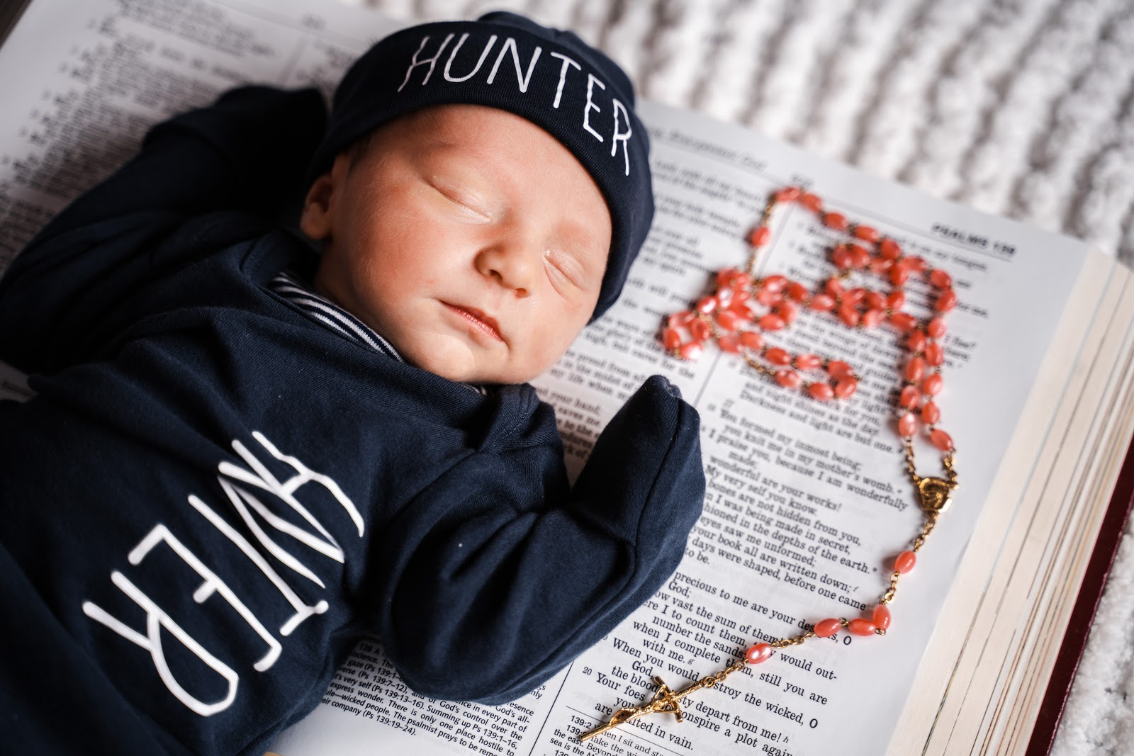 baby-lying-on-bible-near-the-rosary-images