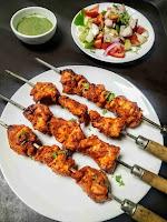 Serving chicken tikka kebab