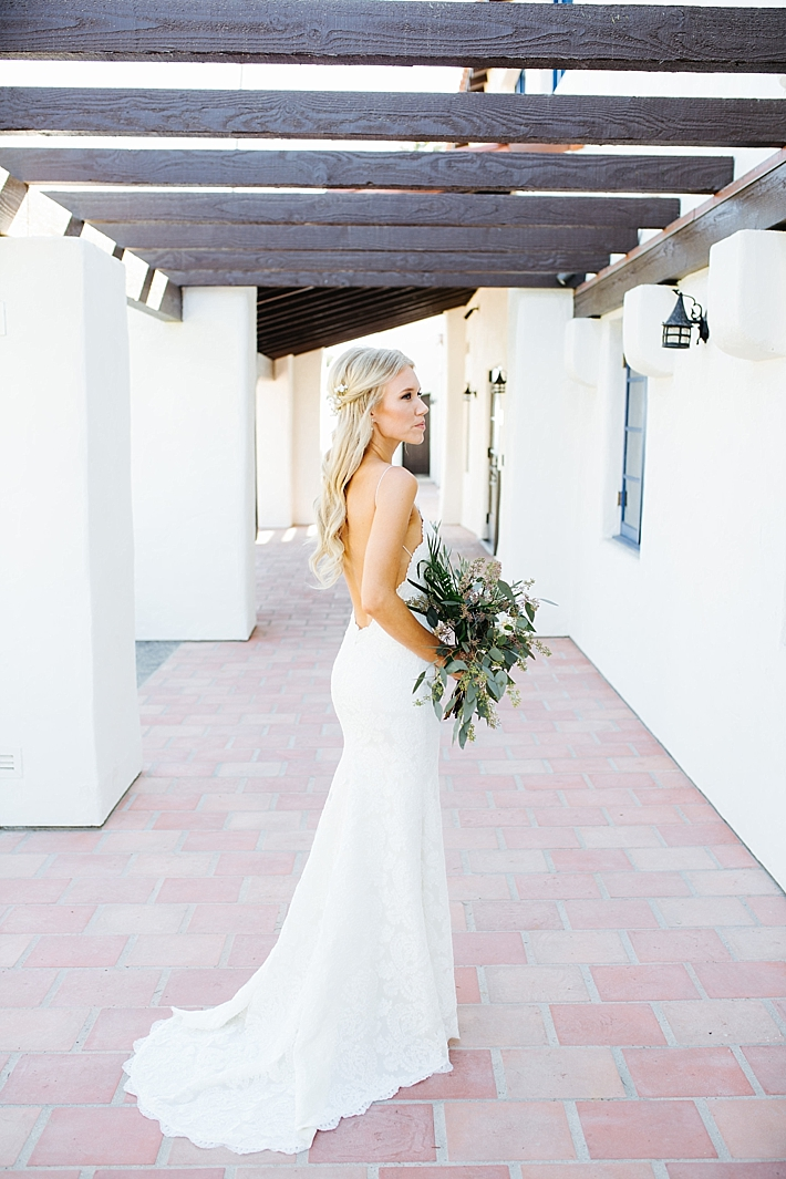 Bride in lace open back wedding dress | Photography: Photography by Ben and Kadin | Wedding Planner: Jessica Lauren Events