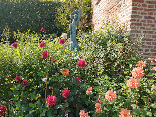 Delightful dahlias and statue