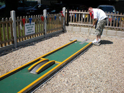 Playing minigolf at Blake End Craft Centre, near Braintree, Essex