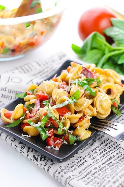 pasta salad on a black plate