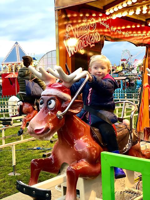 Children's rides at Winter Wonderland a child on a rocking reindeer